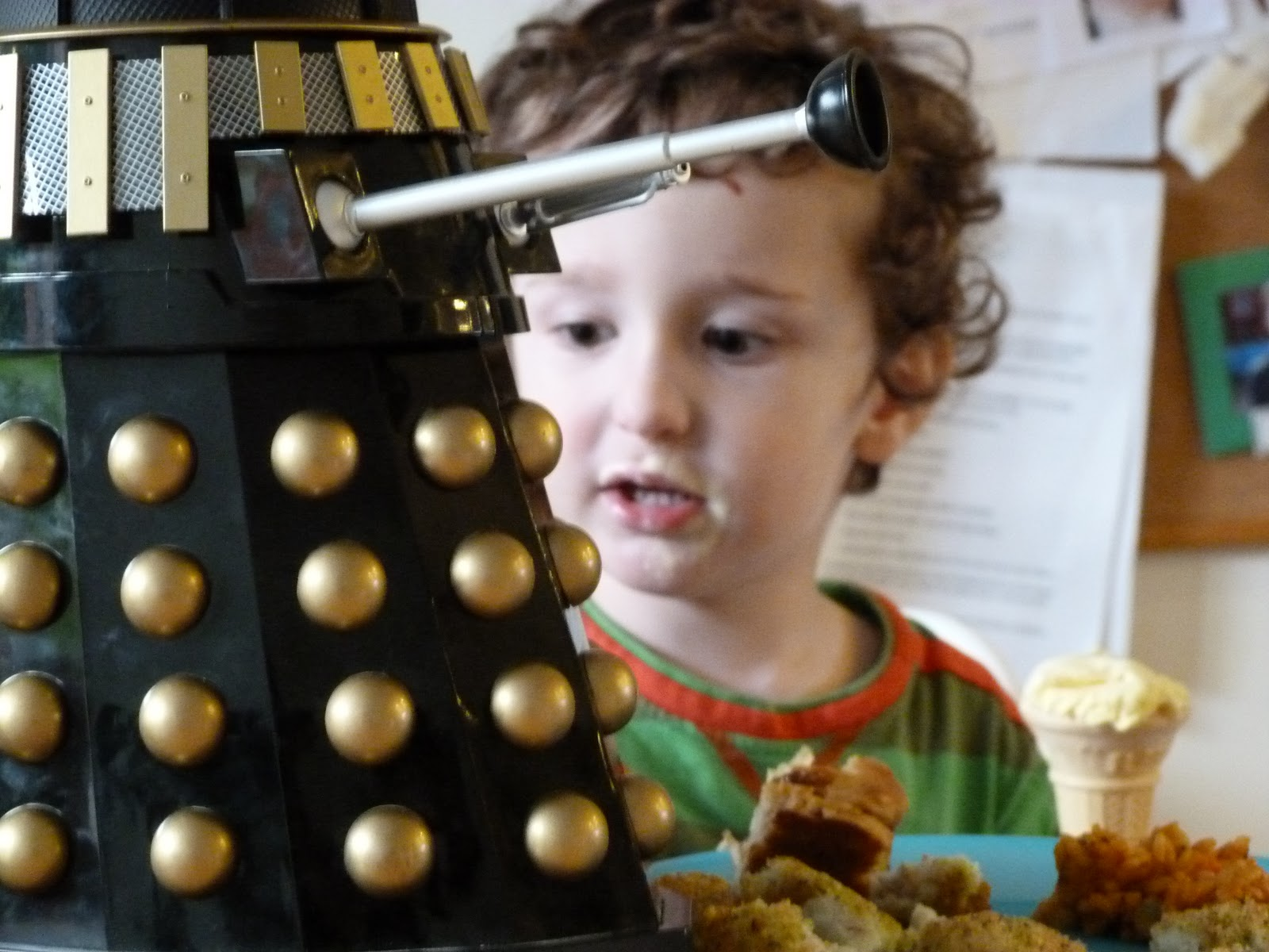 Messy toddler talks to a Dalek