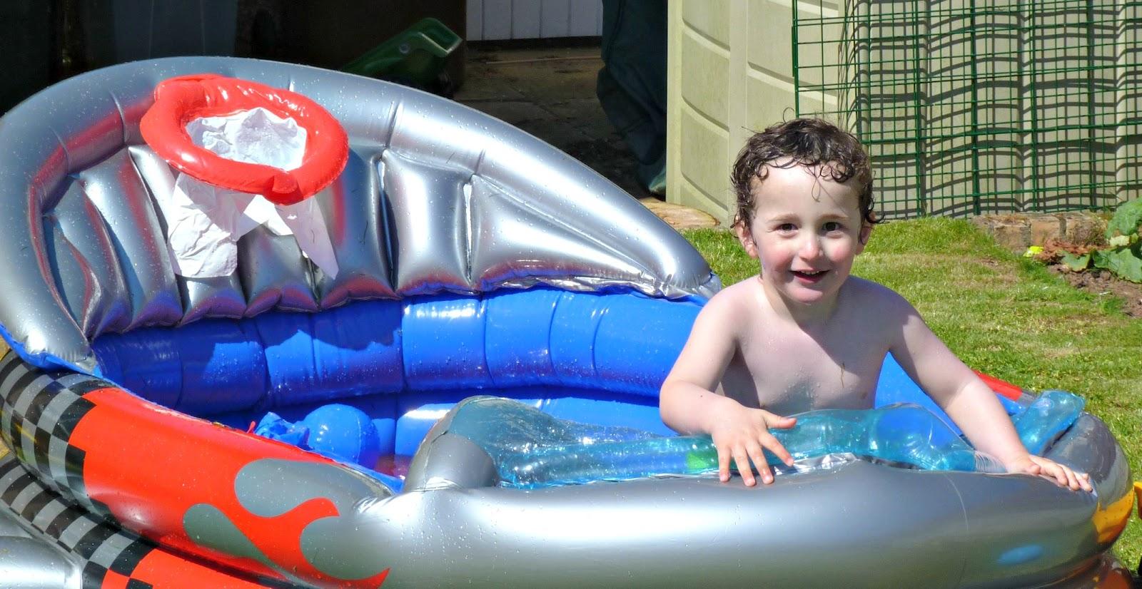 Boy in a paddling pool