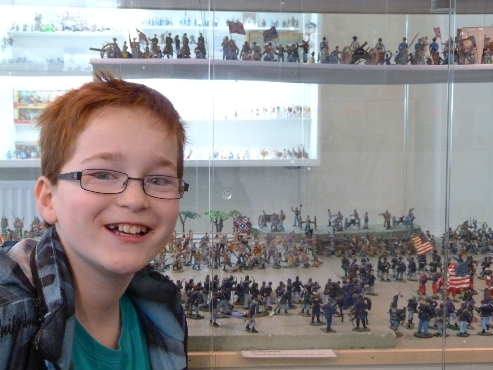 boy with toy soldier display