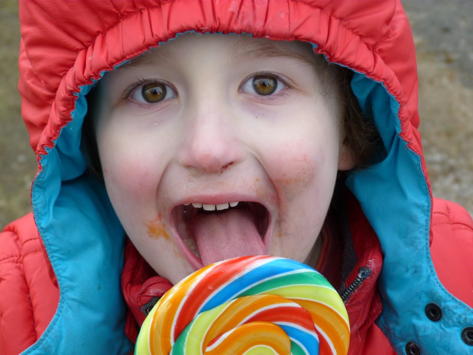 boy licking lollypop