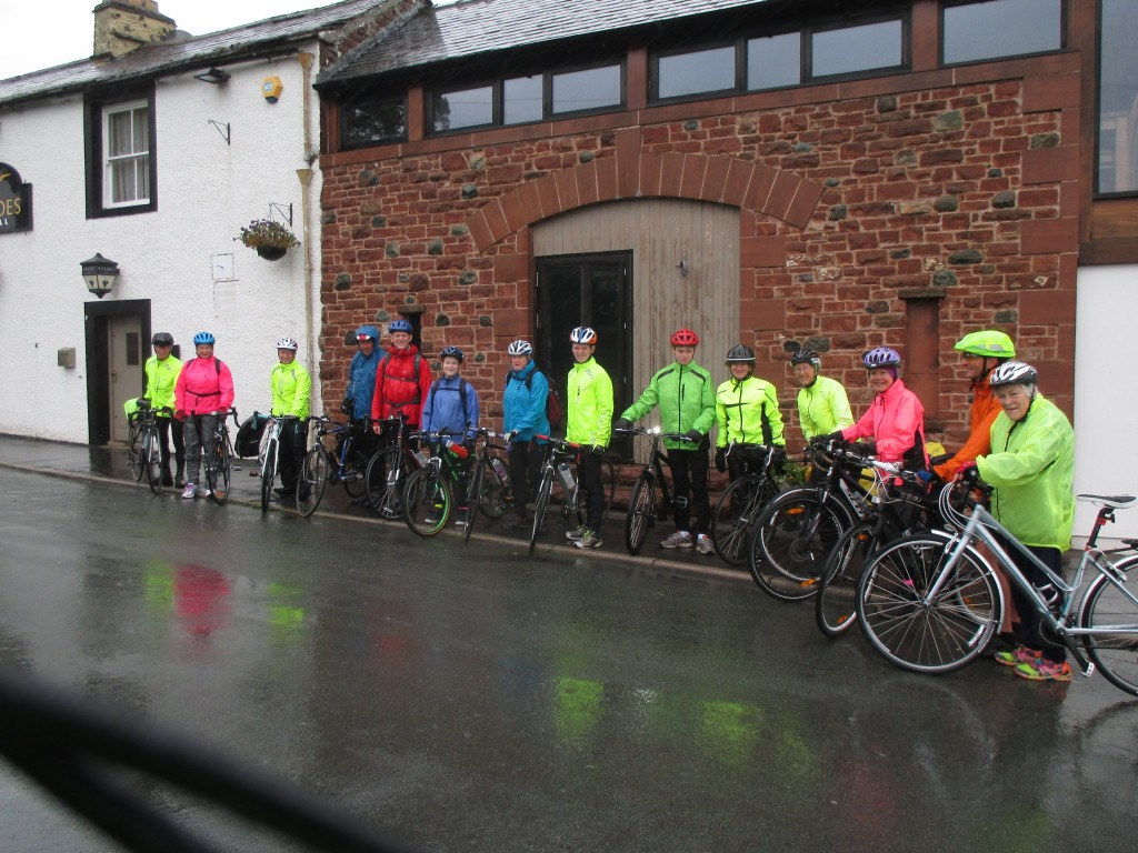 Setting out - The start, notice how the high-viz jackets reflect in the rain.